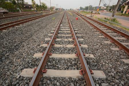 rails of railway forward go into in thailand. Stock Photo