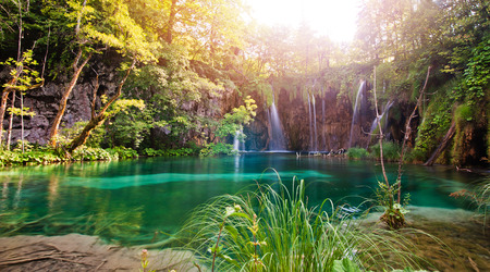 waterfall falling into the lake