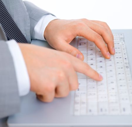 Close up of middle aged business man is working on laptop photo