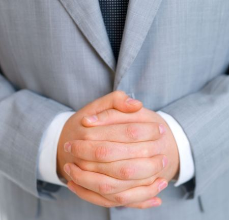 fused: Close up of middle aged business man with fused fingers Stock Photo