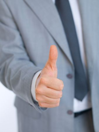 Portrait of handsome businessman showing thumb up hand sign Stock Photo - 3695148