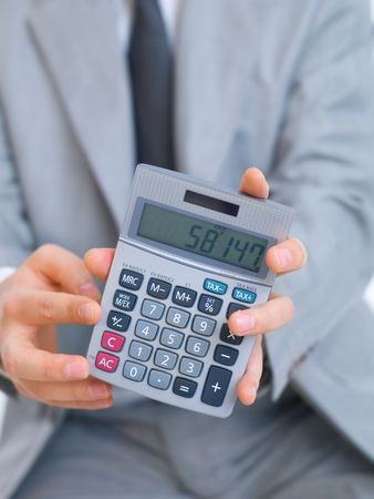 Close up of middle aged business man using calculator photo