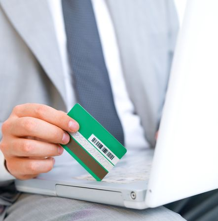 Close up of middle aged business man holding credit card photo
