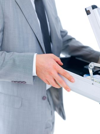 Close up of middle aged business man holding suitcase photo