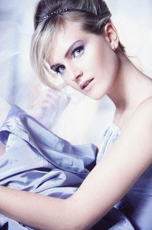 Portrait of a beautiful women wearing vioet dress photo