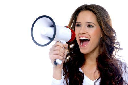 megaphone: Portrait of a beautiful brunette woman shouting through megaphone Stock Photo
