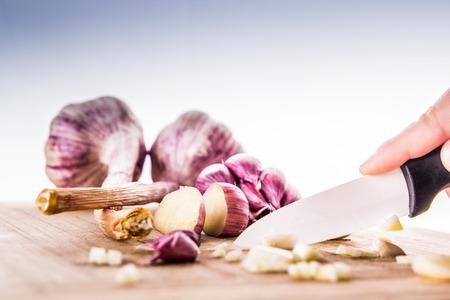 Garlic bulbs on wooden chopping board photo