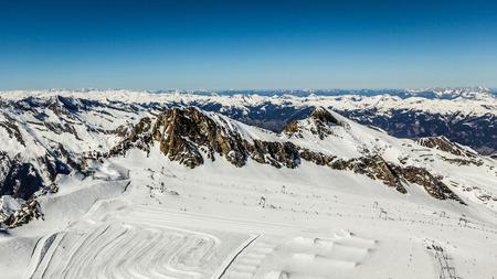 Beautiful view from Kitzsteinhorn peak, Kaprun ski resort in Alps photo