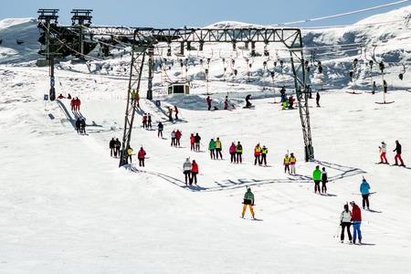 snow grooming machine: People using rope tow systems of Kaprun ski region in Austria