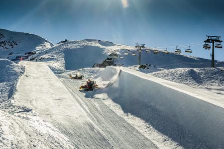 snow grooming machine: Half pipe of Kitzsteinhorn ski resort in Austria with grooming machines