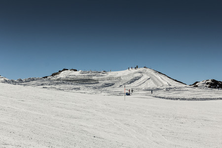 snow grooming machine: Crosscountry skiing slopes in the mountains