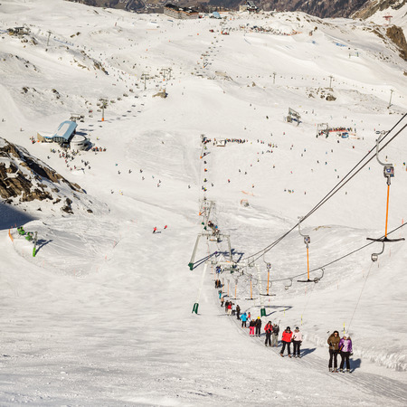 snow grooming machine: People and rope tow systems in one of most popular ski region in Austria Editorial