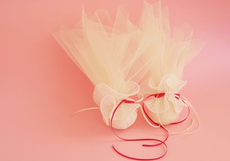 bonbonniere: Two traditional wedding souvenir with candies inside on a pink background