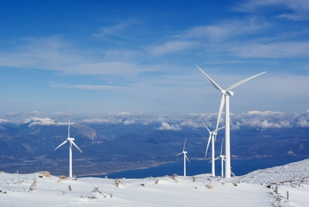windpower: View of the windmills for electricity production on a snowy mountain