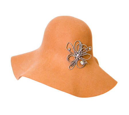 woman brown hat with silver brooch