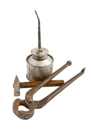 oilcan: The old dirty tin oilcan nail nippers hammer with wood handle isolated