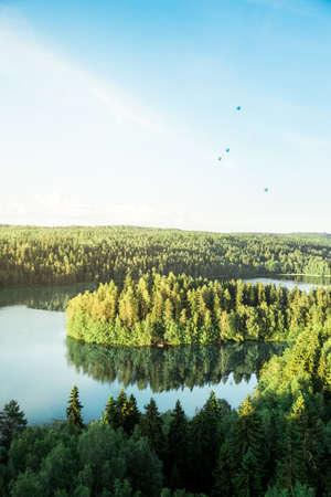 hot air balloons: Island in a calm lake with hot air balloons