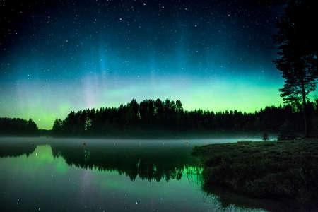 auroral: Aurora borealis by a lake