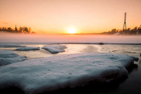 wintery: Wintery seascape at sunset Stock Photo