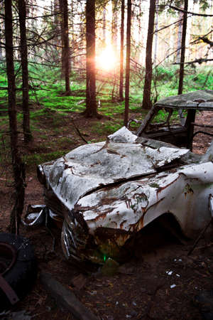 abandoned car: Car abandoned in a forest Stock Photo