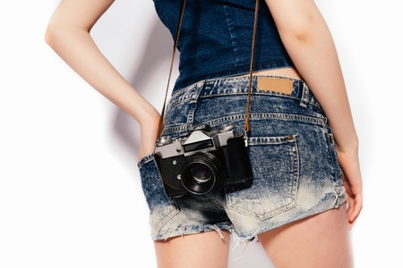body parts: Stylish fashionable blonde girl hipster posing in  studio, body parts Stock Photo