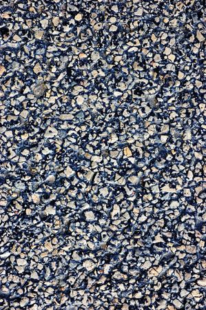 Asphalt texture, detailed tarmac close-up, vertical photo