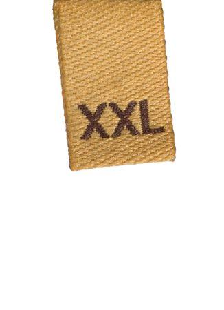 Macro de ropa de etiqueta de tama�o XXL, aislado en blanco Foto de archivo
