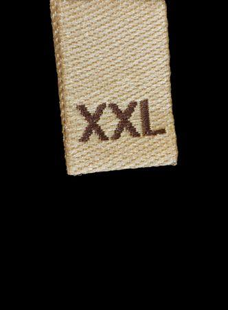 Macro de ropa de etiqueta de tama�o XXL, aislados en negro Foto de archivo