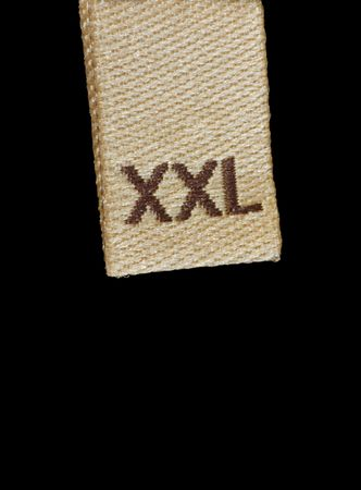 Macro of XXL size clothing label, isolated on black Stock Photo
