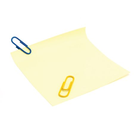 Blank yellow to-do list with paperclips, isolated on white photo