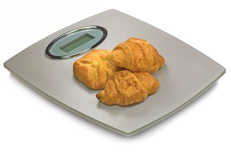 Digital Bathroom Scale And Croissants, Isolated On White photo