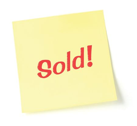 Sticky note indicating item is sold, isolated on white