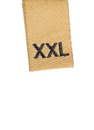 Macro of XXL size clothing label, isolated on white photo