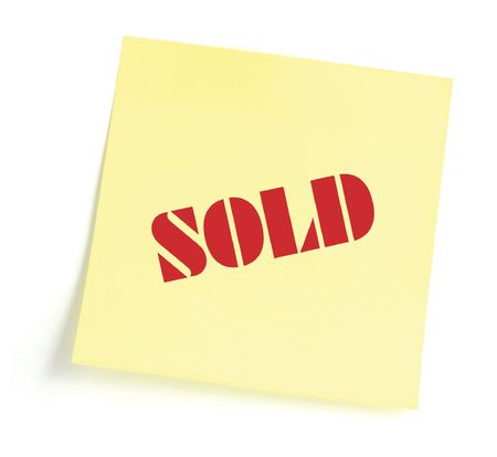 Sticky note indicating item is sold, isolated