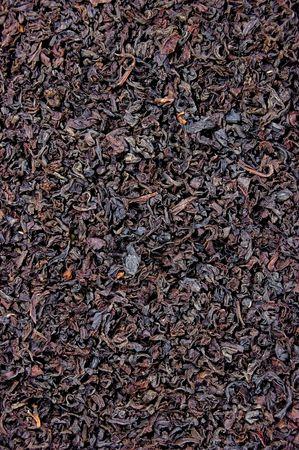 Large Detailed Black Tea Leaf Texture Closeup Background photo