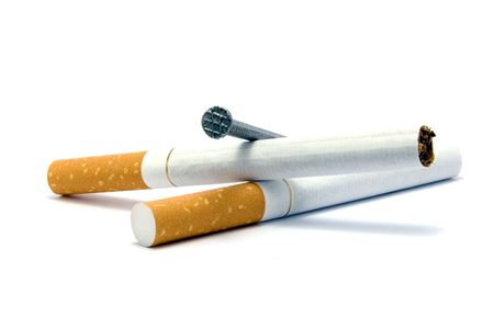 Cigarettes and coffin nail metaphor, isolated on white Stock Photo - 6160083