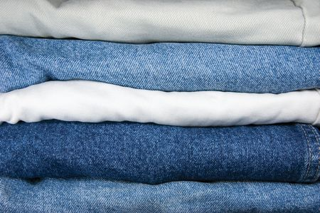 legs folded: Detailed closeup of jeans stack Stock Photo
