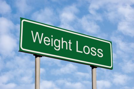 job loss: Weight Loss Green Road Sign, Against Light Cloudscape Sky
