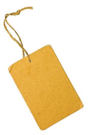 etiquetas de ropa: En blanco la etiqueta de etiqueta de venta de cart�n de grunge amarilla, detalle aislado macro Foto de archivo