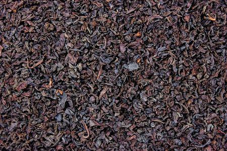 Detailed Black Tea Leaf Texture Closeup Background photo
