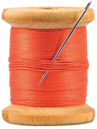 bobbin: Old wooden bobbin with red thread isolated on white