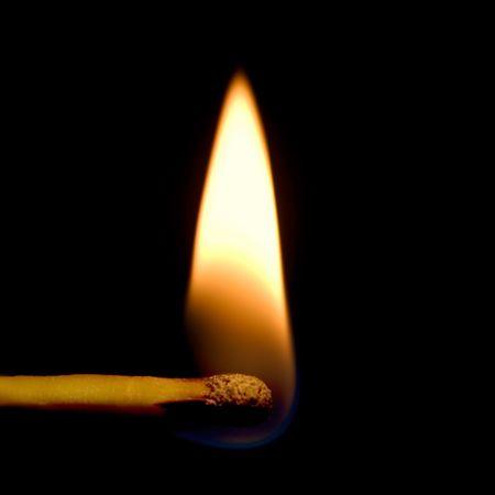 Burning Match Closeup, Isolated On Black photo