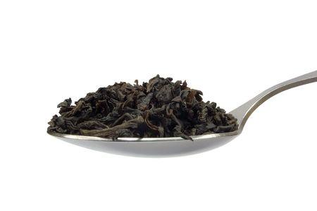 Teaspoon with tea leaf, isolated macro closeup photo