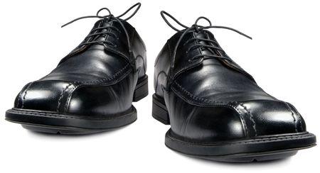 Classic mens black club shoe, isolated wide angle macro closeup photo
