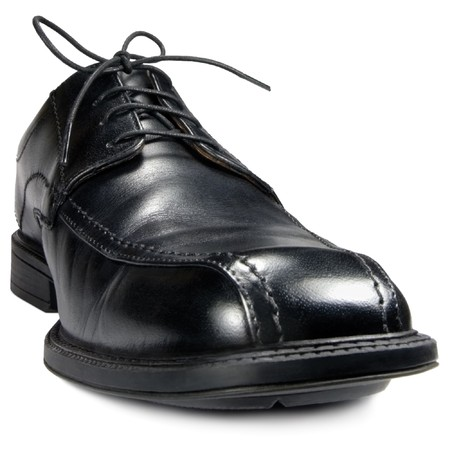 Classic mens black club shoe, isolated wide angle macro closeup photo