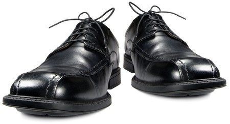 Classic men's black club shoe, isolated wide angle macro closeup
