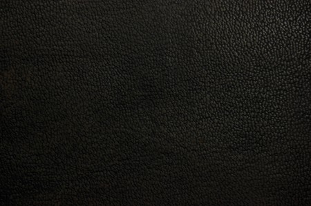 Old natural dark brown black grunge grungy leather texture background, macro closeup photo