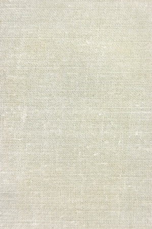 Natural vintage linen burlap texture background in tan, beige, yellowish, grey photo