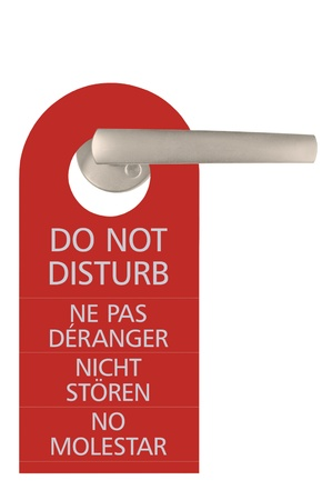 hotel stay: Large Do Not Disturb Tag And Door Handle, Isolated, English, French, German, Spanish Stock Photo