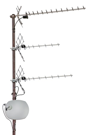 tv station: TV and communication aerials on roof of residential house, isolated antennas and dish